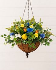 Yellow and blue artificial flowers in a hanging basket