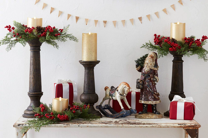 Christmas candle holders and figurines on a table