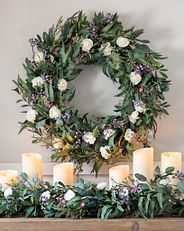 Multicolor floral wreath and garland on mantel