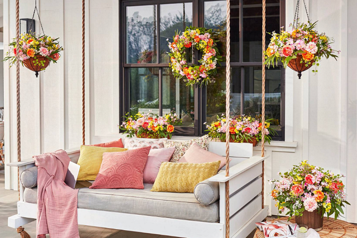 Front porch decorated with assorted artificial flowers